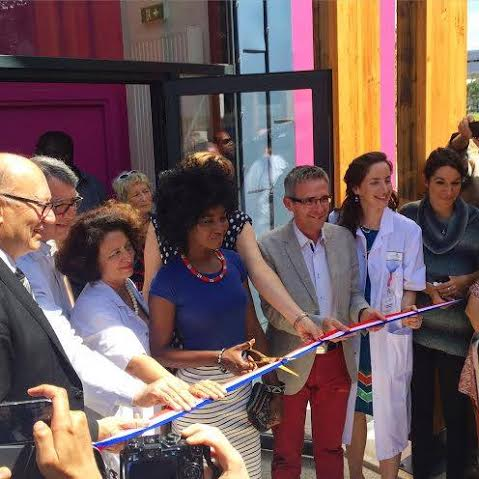 With Ghada Hatem holding, Inna Modja cuts the ribbon